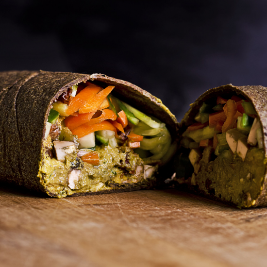 A wrap with vegetables cut in half healthy balanced diet