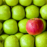A pile of healthy green apples elevate yourself to wellness